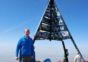 Scott Norris at the summit of Jebek Toubkal