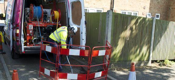 Engineer performing drain jetting