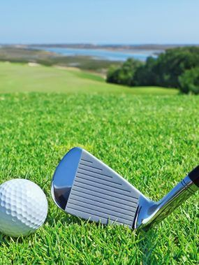 golf-accessories-on-a-background-of-green-course-1