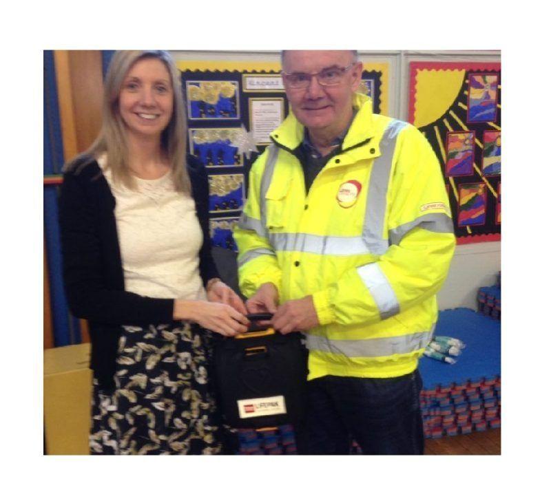 Defibrillator School Donation