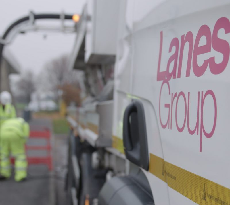 White Lanes Group truck alongside drainage engineers in high-visibility clothing and roadworks