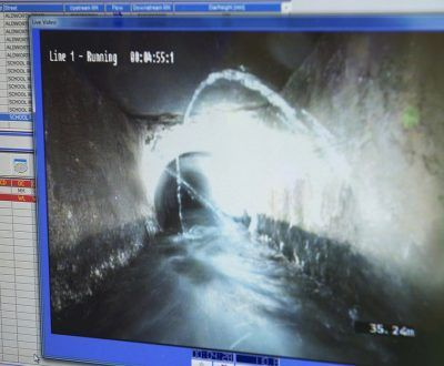 A screen showing the recording of inside a drain or sewer