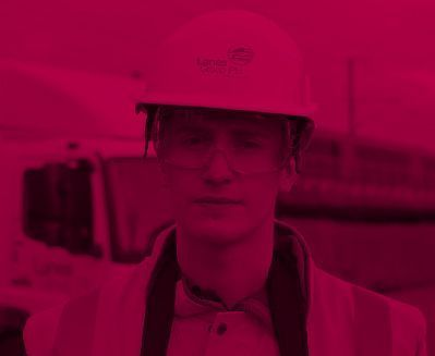 Engineer in hard hat and protective eyewear with a pink colour overlay
