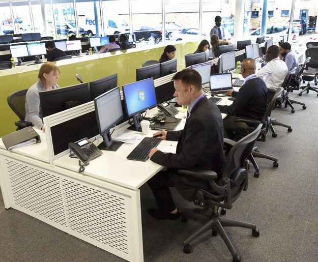 Group of office workers sat at their desks