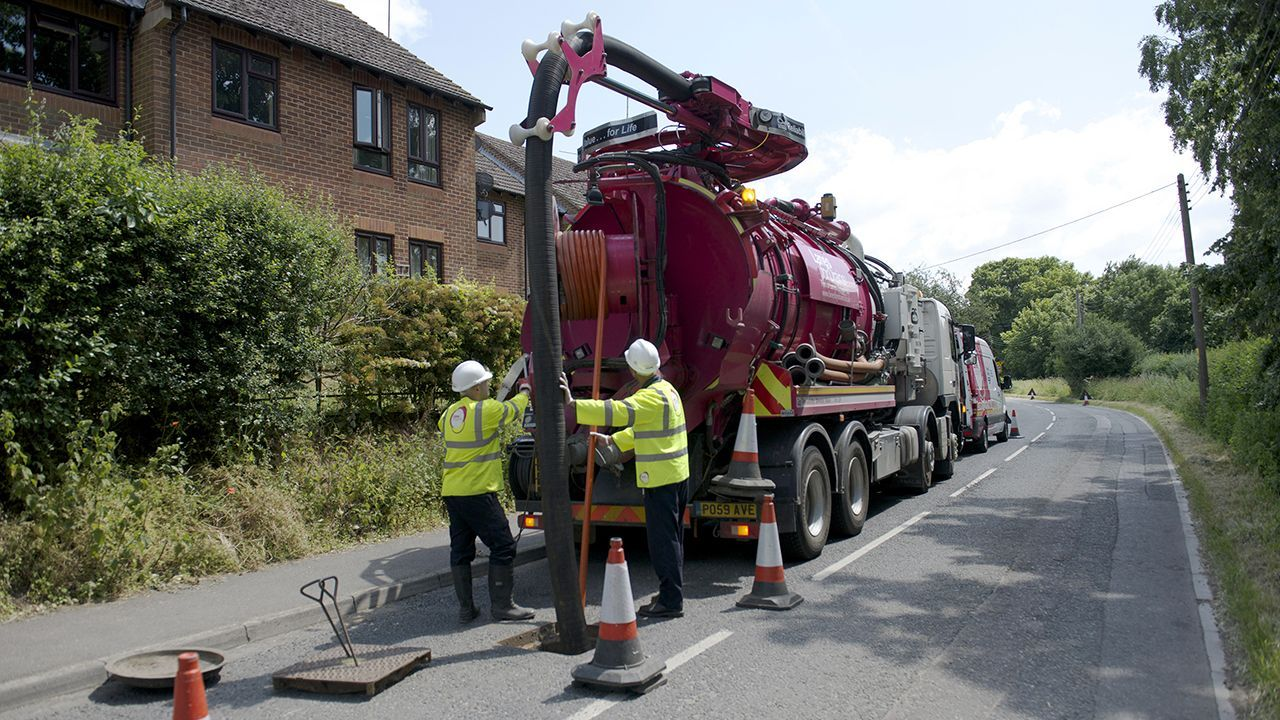 Lanes Group engineers operating a jet vacuumation tanker on the road