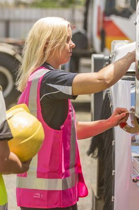 Engineer in pink high visibility vest