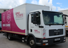 Lanes Group PLC branded truck carrying ultra violet rehabilitation equipment