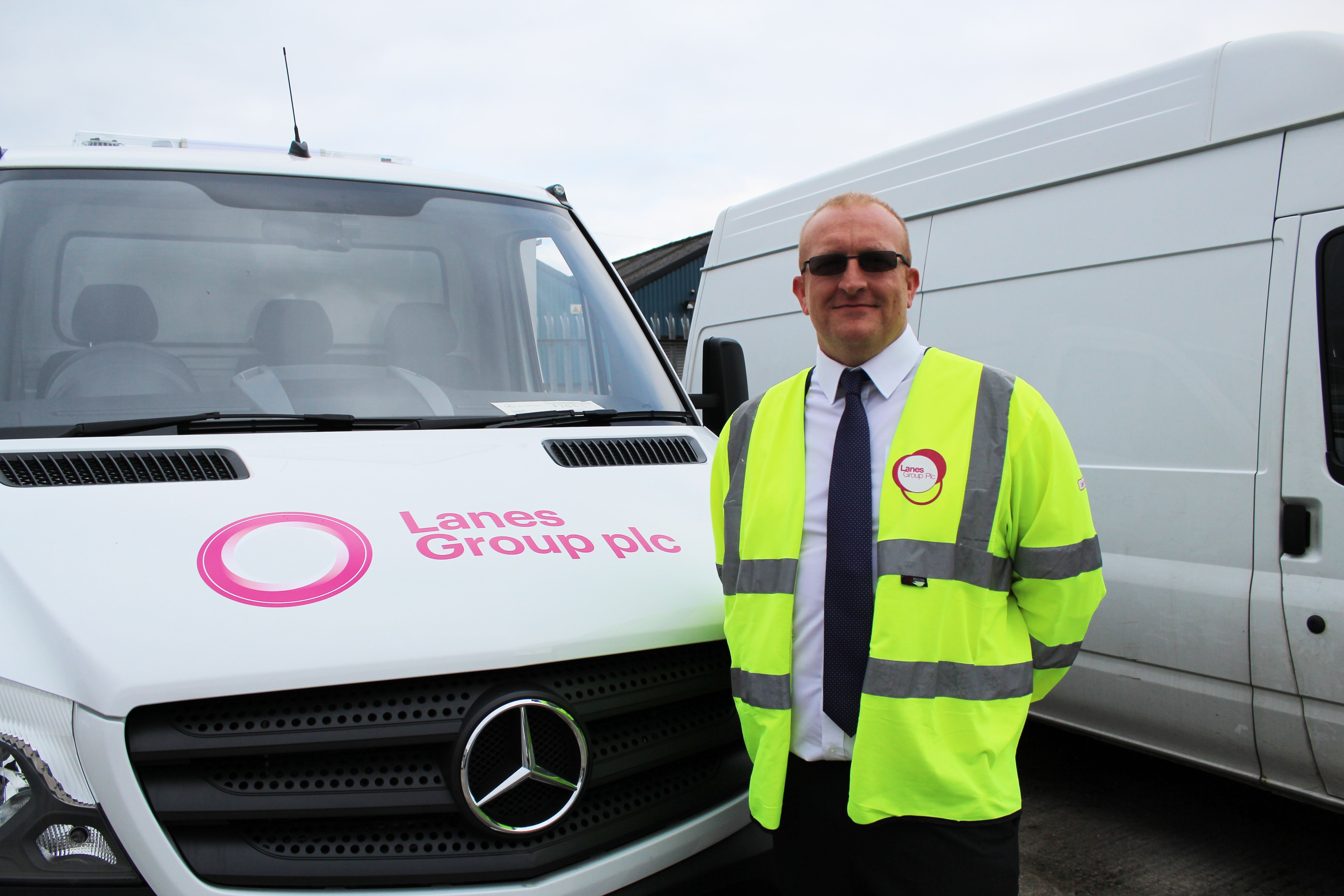 Chris Wilde standing in front of a Lanes Group van
