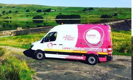 Lanes Group PLC branded van parked in countryside
