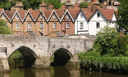 Bridge over river in Sevenoaks with houses in the background