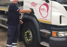 Simon Rouse stands with Lanes Tanker