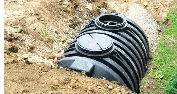 An unearthed septic tank