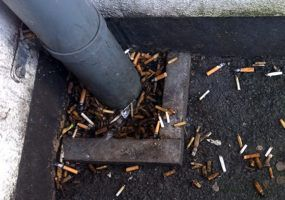 Smoking kills, fag butts on ground
