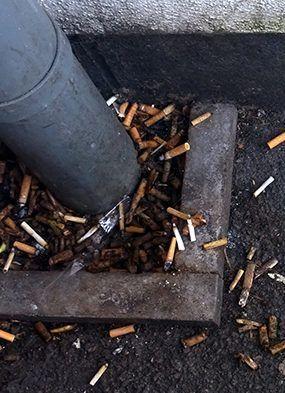 Smoking kills, fag butts on ground