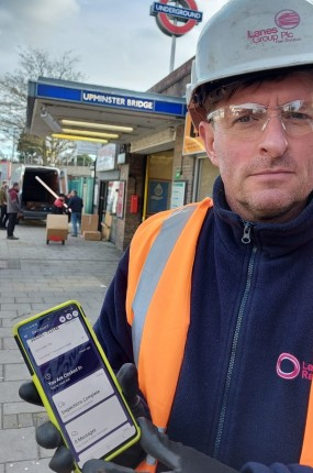 Lanes Rail Team Leader James Gooch with his Team Leaf enabled phone. Helping him and his colleagues carry out maintenance across the London Underground network.